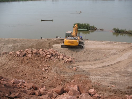 Building road in Laos using a heavy excavator.