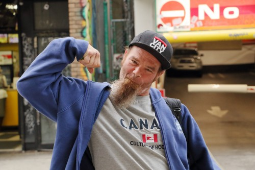 "Met this fella at Kensington Market while I was snapping pics. He told me if I wanted to take pics, I should take a pic of him.  I agreed, and it turned out really well in my humble opinion.    I'll call this piece ""True Canadian Flexing"". 😁  P.S. This is what I called a proud quintessential true Canadian. He was nice, got the gears and that pose is the best!"