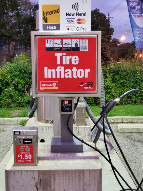 tire-inflator-accepts-debit-tap.jpg